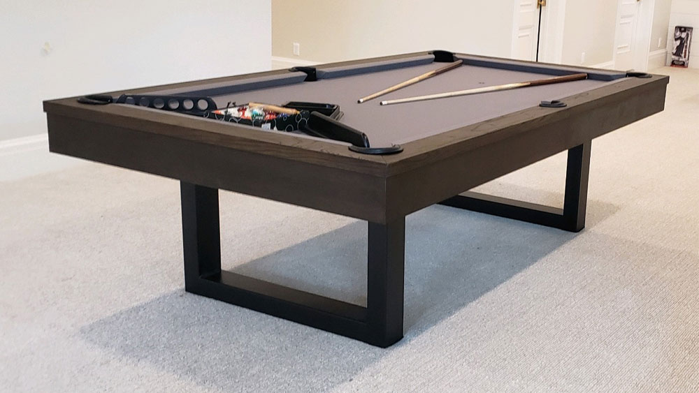 A pool table set up in a room.